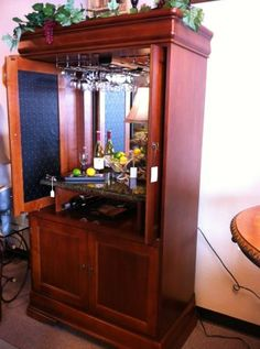 This is an example of a relatively recent entertainment armoire repurposed as a wine bar.  This was on Craigslist.org for Killeen, Texas.