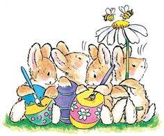Easter bunnies painting eggs