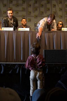 "AWWWW. Love the look on the other Castle guys' faces. ""Nathan Fillion getting to know one of his younger fans who dressed up as Malcolm Reynolds."""