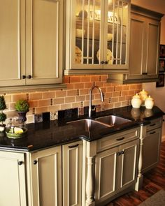 1000 images about newell house on pinterest vent hood - Black granite countertops with cream cabinets ...