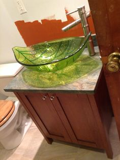 """Here are pictures from my actual bathroom remodel!  Cabinet and sink from menards, faucet is Krauss (online) and paint is """"falling leaves"""" (unfinished paint job!)."""