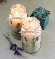 DIY Pressed Herb Candles. Made with lavender and chocolate mint. A great way to keep fresh herbs safe for the rest of the year.