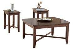 """With a sleek contemporary design and a rich warm finish, the """"Abram"""" accent table collection creates the perfect tables to enhance the beauty of any living room decor. The medium brown finish flows beautifully over the subtly rounded shape of the table tops and stylishly tapered legs to create the inviting feel of this exciting contemporary collection."""
