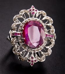 This is what you call a cocktail dress ring. A large ruby set with rose cut diamonds in silver.