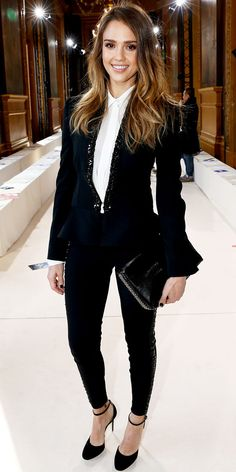 Jessica Alba suited up for the Stella McCartney Paris Fashion Week show in the designer's slim black ensemble and coordinating accessories.