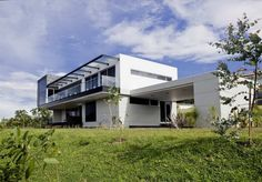 Designed by Carlos Eduardo Molina Londono Architect, this suburban home is situated in the east of Medellin, Colombia