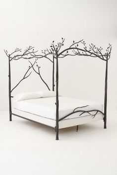Forest Canopy Bed - Anthropologie.com by elizabeth_ward98 liked from a luxurious wicker sofa.