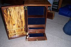 A walnut and spalted elm jewelry cabinet that I made for my oldest daughter.