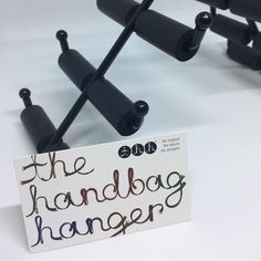 thh - the handbag hanger. The only place your handbags should be when they are not on you. ❤️