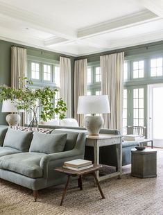 Sophisticated sage green, ivory and wood living room.