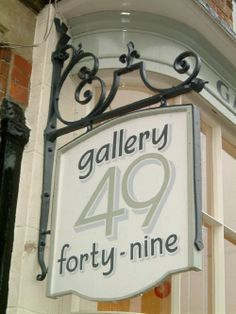 wrought iron hanging sign.JPG (500×666)