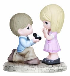 Precious Moments Figurine, Boy Proposing to Girl Precious Moments http://www.amazon.com/dp/B00GXFSRBU/ref=cm_sw_r_pi_dp_LcG7ub1SBWENX
