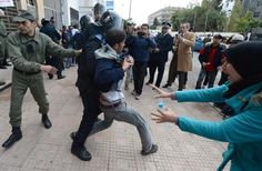 Unemployed and visually impaired Moroccan graduates scuffle with security forces as they try to enter the Ministry of Solidarity, Women, Family and Social Development in Rabat, on Thursday, to protest against unemployment. (AFP/File)