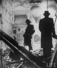 Winston Churchill inspects the ruins of the House of Commons after a German air raid.