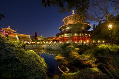 A nighttime view of a lily pond, verdant grounds and buildings at the China Pavilion at Epcot theme park Disney World Theme Parks, Disney World Vacation, Disney World Resorts, Disney Vacations, Disney Trips, Disney Parks, Walt Disney World, Disney Honeymoon, Disney Travel