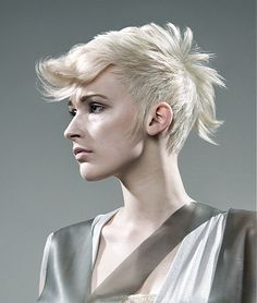 A short blonde straight spikey Layered hairstyle by Rush
