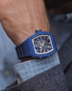 The Richard Mille Blue Ceramic EMEA is equipped with the new calibre with a declutching rotor system, which prevents the watch from overwinding. Richard Mille, Dream Watches, Cool Watches, Sport Chic, Festina, Rolex, Tourbillon Watch, Hand Watch, Tiffany Jewelry