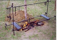 Campfire cook set with moveable pot bars over a trench fire -- Chuck Wagon Cooking at cowboycooking dot com
