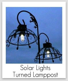 Great Idea -- Make a lamp post with solar lights and inverted hanging baskets. Hang from iron plant hangers. Outdoor Solar Lanterns, Outdoor Hanging Lights, Outdoor Lighting, Yard Lighting, Outdoor Lamps, Lighting Ideas, Solar Light Crafts, Solar Lights, Diy Solar