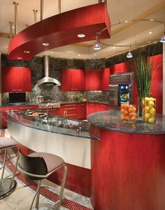 Looking for a more urban feel to your kitchen? Try using red and grey to bring in the industrial touches.   www.remodelworks.com