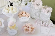 Lots to love here, but what catches my eye are those mason jars covered in lace!