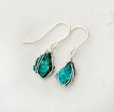 Turquoise Earrings Wrapped in Silver.Rough Cut Raw Stone Earrings.Silver Earrings.Raw Stone Jewelry.Rustic,Small,light Earrings.Teal Earring  https://www.etsy.com/il-en/listing/253859939/turquoise-earrings-wrapped-in?ref=shop_home_active_16