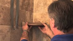When you consider shower tile ideas, think about putting in a stone corner shelf as well. This Tile Shop DIY video identifies the necessary tile accessories .