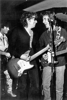 Bob Dylan & George Harrison share a moment. Found on americansongwriter.com
