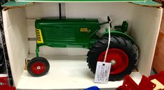 SOLD! Oliver 77 wide front tractor in 1/16 scale. Made in USA. New in Box.  See in Case 244 ... $sold