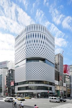 Klein Dytham Architecture was commissioned by Ginza Place to design this incredible perforated facade inspired by traditional Japanese crafts. The design is comprised of over… Commercial Architecture, Facade Architecture, Amazing Architecture, Landscape Architecture, Building Exterior, Building Design, Facade Design, Exterior Design, Mall Facade