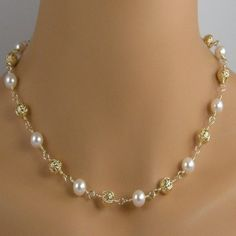 Lovely white pearl and 22k gold plate filigree bead necklace with 14k gold filled lobster clasp.  http://jewelrybytali.com/products/gold-filigree-white-pearl-necklace-gold-bead-white-pearl-necklace