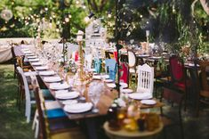 Romantic vintage reception from Green Wedding Shoes. Love the mismatched chairs!