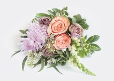 The Marie - For The Creme de Le Creme - This bouquet is a lavish nod to palace life with opulent peach roses, lavender roses and pink mums. Send this bouquet to your crème de la crème, or keep it all for yourself. After all, we know well-behaved people rarely make history. Suggested note: Looks like you CAN have your cake and eat it, too. Send for just $55 + free delivery.