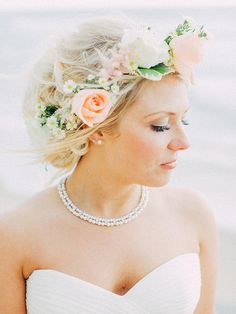 Give your messy updo even more of romantic vibes with a flower crown of daisies, pink astilbe and roses.