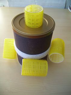 do-it-yourself motor skills activity: pushing hair rollers in a can