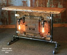 Industrial steampunk pipe and barn wood edison light table, By the Machine Age Lamp Company