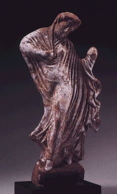 Greek terra-cotta figure of dancing woman, Boeotia,   circa mid-4th Century, B.C.,