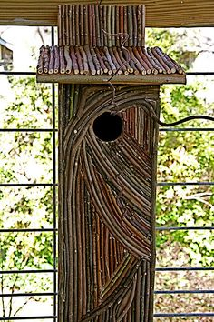 Great way to dress up a boring flicker house! Twig enhanced birdhouse by Pandorea..., via Flickr