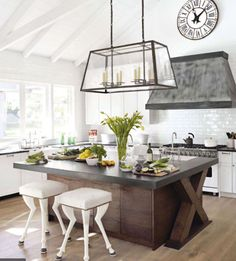 This wide, airy kitchen includes whimsical nods to equestrian elements (look closer at the stools)