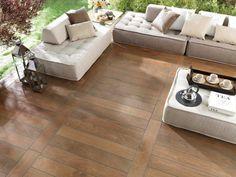 beau calepinage - Une vue d'en haut d'un carrelage jardin en bois et des meubles de jardin chic