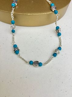 The perfect anklet to add to your wardrobe. This turquoise blue beaded anklet with flowers, butterflies and hearts charm will be a fun staple in your wardrobe! Here are the details of this anklet! Beaded Anklet is featured with Tibetan Silver flowers, Butterflies and heart spacers,