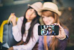 Women Taking Selfie  by Mosuno