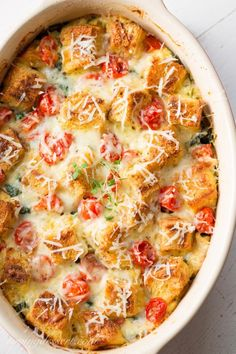 Spinach, Onion & Cheese Breakfast Strata ~ a delicious make-ahead, overnight breakfast or brunch casserole. You won't miss the meat with hearty chunks of Italian bread, ripe cherry tomatoes and rich Gruyere cheese this breakfast casserole is sure to please your hungry crowd!