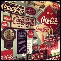 Coca Cola vintage wall decor advertisements.