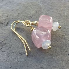 Hand faceted rose quartz cubes are the focal point of these earrings. The 7mm rose quartz cube sits a top a moonstone rondelle. Finished with small gold vermeil beads and ear wires. These pretty earrings are 1 inch in length.  FREE SHIPPING WITHIN THE UNITED STATES  Your jewelry will arrive in a cotton lined kraft box within a padded postal envelope. I use USPS first class mail. This usually takes 3 to 5 days to ship. International orders outside of the U.S. will take 8 to 15 days to ship…