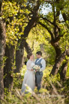 Bride and groom portrait in gorgeous forest.