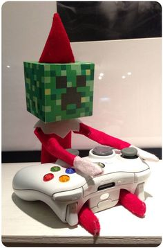 Elf on the Shelf Ideas plus a printable for creating a Minecraft Creeper Head fo., on the Shelf Ideas plus a printable for creating a Minecraft Creeper Head for your Elf! Christmas Elf, Christmas Crafts, Minecraft Christmas, Christmas Carol, Family Christmas, Der Elf, Elf Auf Dem Regal, Elf Magic, Claudia S