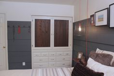 Finally, Monica and Jess cut the couple's larger dresser to fit inside their closet and built doors on top, creating the look of built-in cabinets.