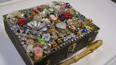 Old vintage jewelry on a cigar box...a great way to craft forward your mother's/grandmother's jewelry