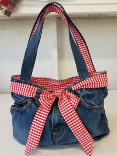 Your place to buy and sell all things handmade - - Selling as fast as I can make them, see at my shop: Purse, recycled jeans with red gingham lining and sash. Zipper closure, denim and denim gingham handles. 13 x 10 x 4 inches Denim Bags From Jeans, Denim Purse, Jean Crafts, Denim Crafts, Shopping Outfits, Blue Jean Purses, Denim Handbags, Patterned Jeans, Denim Ideas